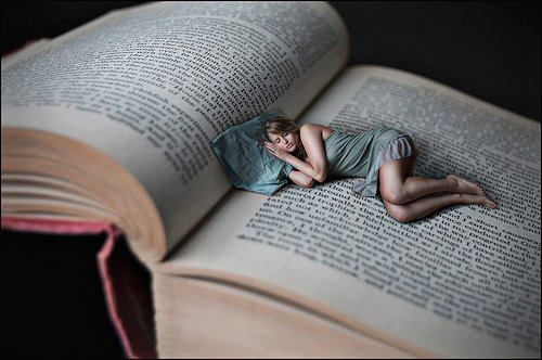 Woman_sleeps_in_a_book